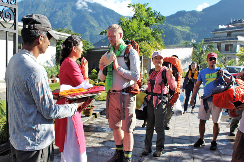 A tourist being welcomed on the occasion of 37th World Tourism Day organised by Annapurna Conservation Area in Besishahar of Lamjung district, on Tuesday, September 27, 2016. Photo: RSS