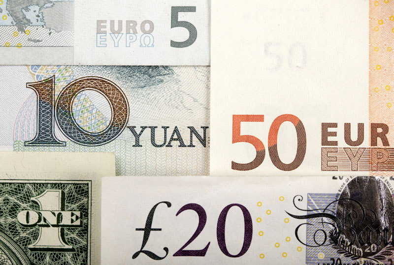 Arrangement of various world currencies including Chinese Yuan, US Dollar, Euro, British Pound, in this picture illustration taken on January 25, 2011. Photo: Reuters