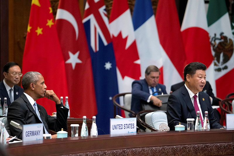 US President Barack Obama watches as Chinese President Xi Jinping speaks at the opening ceremony of the G20 Summit in Hangzhou, Zhejiang province, China, on September 4, 2016. Photo: Reuters
