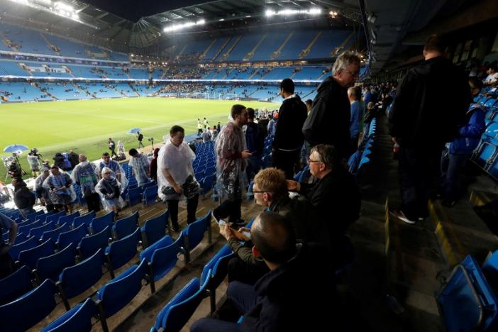 Football Soccer Britain - Manchester City v Borussia Monchengladbach - UEFA Champions League Group Stage - Group C - Etihad Stadium, Manchester, England - 13/9/16nFans leave the stadium after the match has been postponednAction Images via Reuters / Carl Recine