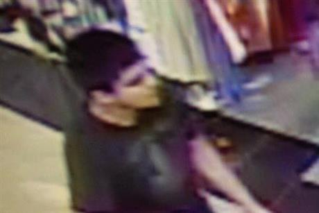 This video image provided by Skagit County Department of Emergency Management shows a suspect wanted by the authorities regarding a shooting at the Cascade Mall in Burlington, Wash., Friday, Sept. 23, 2016.  AP