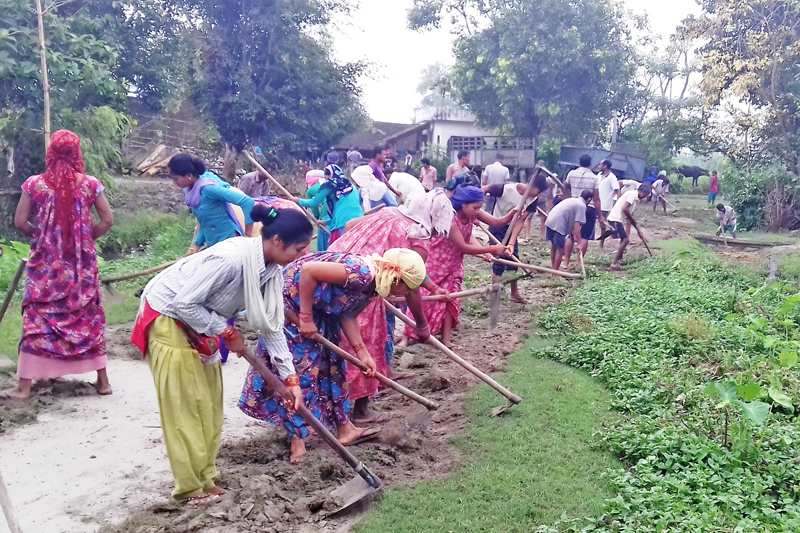 Locals of Belauri in Kanchanpur district working before the road is gravelled, on Friday, September 2, 2016. Photo: RSS