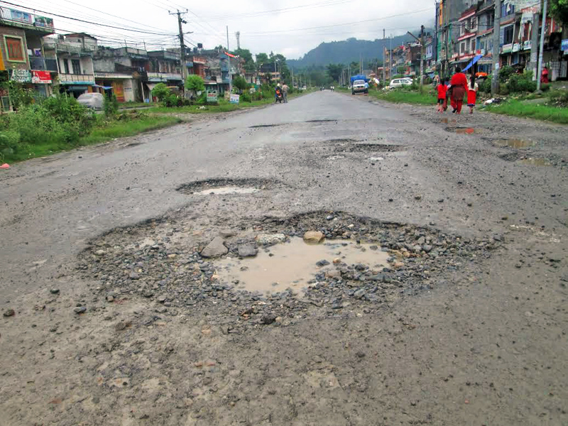 Potholes seen at Khairenitar bazaar along Prithvi Highway, in Tanahun, on Sunday. Road accidents have risen sharply due to potholes on the road, on Sunday, September 18, 2016. Photo: THT