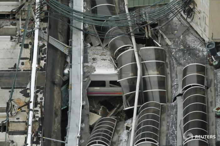 A derailed New Jersey Transit train is seen under a collapsed roof after it derailed and crashed into the station in Hoboken, New Jersey, U.S. September 29, 2016.    REUTERS/Carlo Allegri