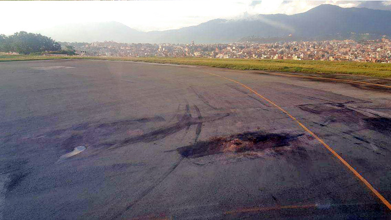Cracks and potholes can be seen on Tribhuvan International Airport runway, raising safety concerns, on Thursday, September 15, 2016. Photo: THT