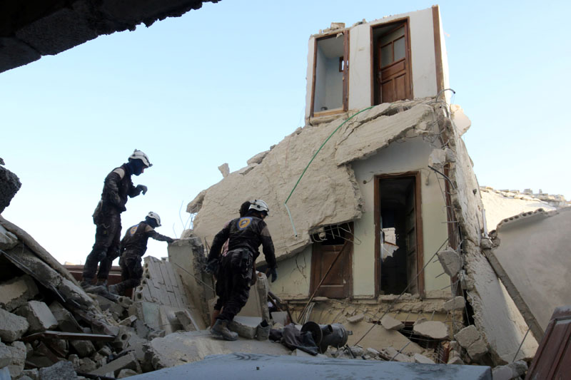 Civil Defence members inspect a damaged site after an airstrike in the besieged rebel-held al-Qaterji neighbourhood of Aleppo, Syria, on October 14, 2016. Photo: Reuters