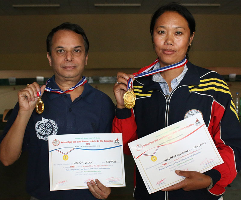 Ashim Yadav and Phul Maya Kyapchhaki hold the medals after the National Open Shooting Tournament in Lalitpur on Wednesday, October 27, 2016.