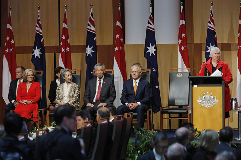 Singapore's Prime Minister Lee Hsien Loong (centre) and his wife Ho Ching (second left) sit with Australian Prime Minister Malcolm Turnbull (second right) and his wife Lucy Turnbull (left) in the Great Hall of Parliament House as Ngunnawal Elder Jannette Phillips (right) makes a welcome to country speech during a traditional Aboriginal welcome, in Canberra, on Wednesday, October 12, 2016. Photo: AP
