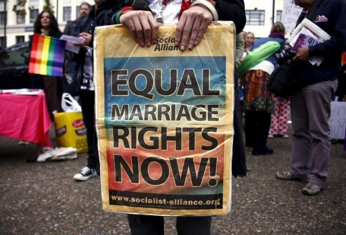 A gay rights activist holds a placard during a rally supporting same-sex marriage, in Sydney, Australia, on May 31, 2015. Photo: Reuters