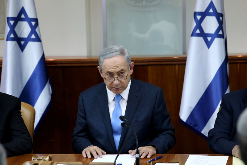 Israeli Prime Minister Benjamin Netanyahu opens the weekly cabinet meeting at his Jerusalem office moments after he was informed about a shooting attack in Jerusalem, on October 9, 2016. Photo: Reuters