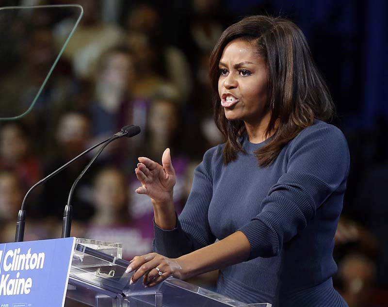 First lady Michelle Obama speaks during a campaign rally for Democratic presidential candidate Hillary Clinton, in Manchester, New Hampshire, on Thursday, October 13, 2016. Photo: AP