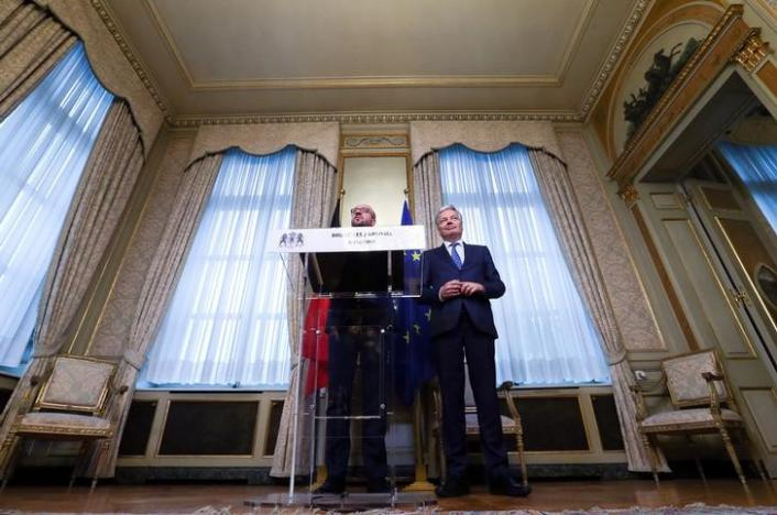 Belgium's Prime Minister Charles Michel (L) and Foreign Minister Didier Reynders address a statement at the end of a meeting on the Comprehensive Economic and Trade Agreement (CETA), a planned EU-Canada free trade agreement, at the Lambermont Residence in Brussels, Belgium, October 27, 2016. REUTERS/Yves Herman