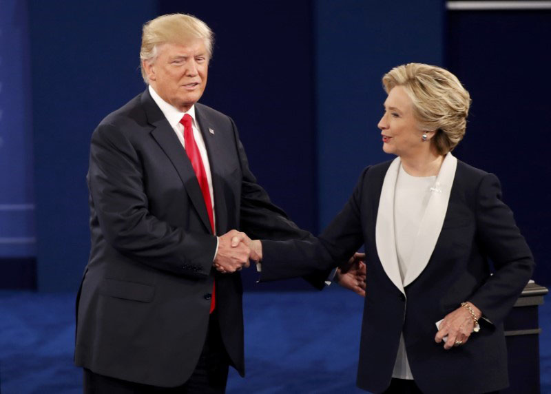 Republican US presidential nominee Donald Trump and Democratic US presidential nominee Hillary Clinton shake hands at the conclusion of their presidential town hall debate at Washington University in St Louis, Missouri, US, on October 9, 2016. Photo: Reuters