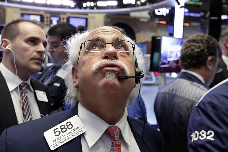 Trader Peter Tuchman (centre) works on the floor of the New York Stock Exchange, on Wednesday, October 5, 2016. Energy stocks are leading an early gain on Wall Street as the price of crude oil moves higher. Photo: AP