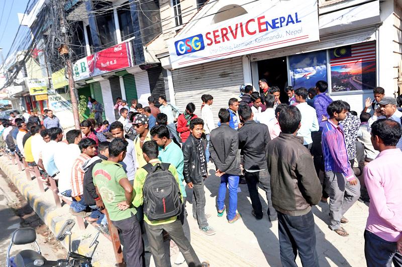 Malaysian job aspirants queuing to record their finger prints at a local agency in Uttar Dhoka, Kathmandu, on Friday, October 21, 2016. Photo: RSS
