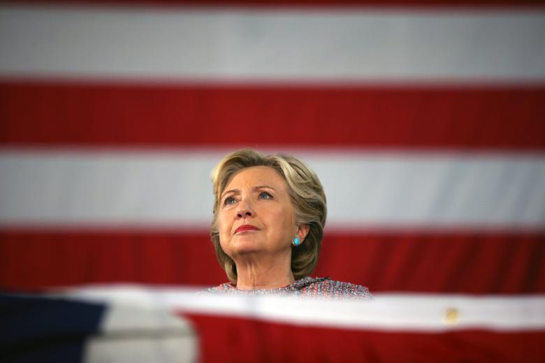 US Democratic presidential nominee Hillary Clinton listens to former Vice President Al Gore talk about climate change at a rally at Miami Dade College in Miami, Florida, U.S. October 11, 2016. Photo: Reuters