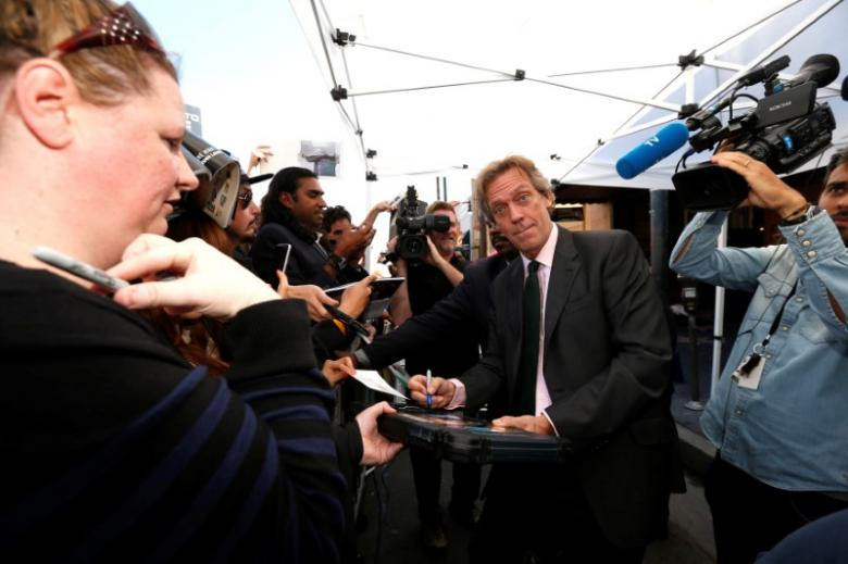 Actor Hugh Laurie signs autographs after unveiling his star on the Hollywood Walk of Fame in Los Angeles, California U.S., October 25, 2016.   REUTERS/Mario Anzuoni