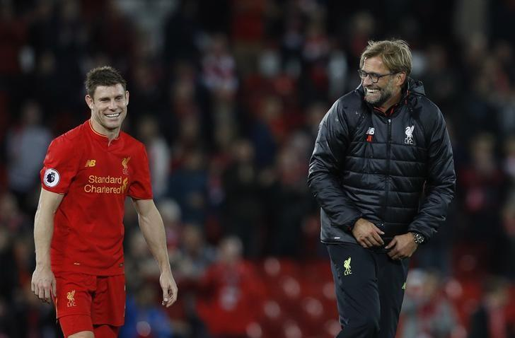 Britain Soccer Football - Liverpool v West Bromwich Albion - Premier League - Anfield - 22/10/16nLiverpool manager Juergen Klopp celebrates with James Milner after the gamenReuters / Phil NoblenLivepic