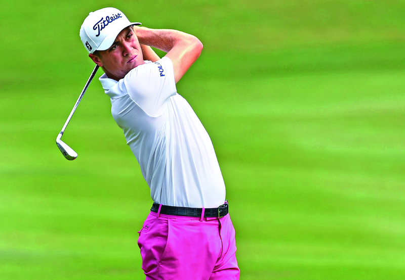 Justin Thomas of the US plays a shot during the second round of 2016 CIMB Classic golf tournament in Kuala Lumpur on October 21, 2016. Photo: AP