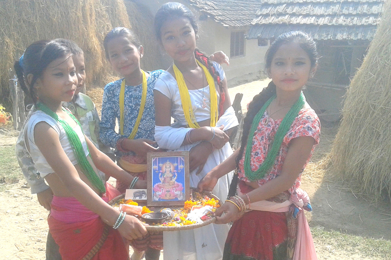 Girls in Kanchanpur district pose for a photograph while they play Bhailo to mark the annual Tihar festival on Monday, October 31, 2016. Photo: RSS