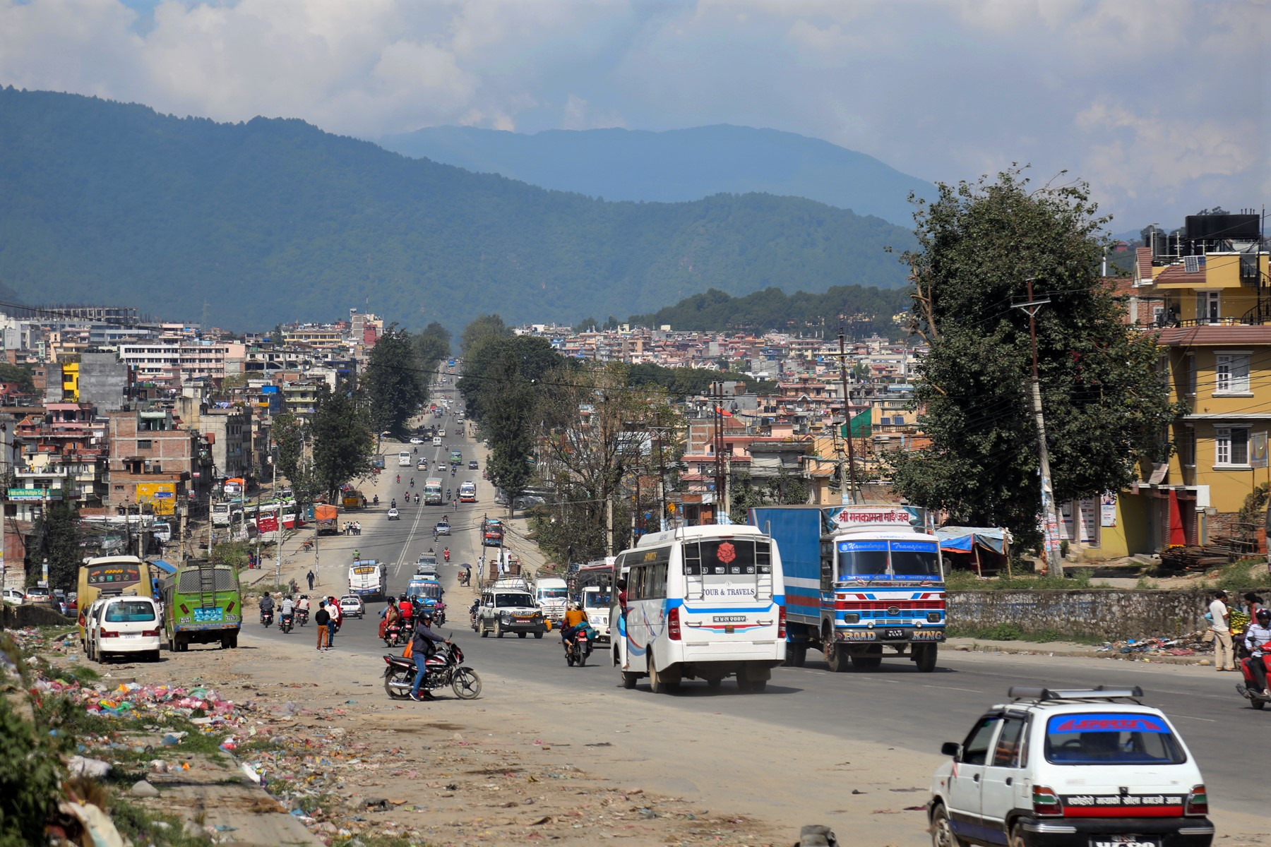 Vehicles ply on the roads in Kalanki of Kathmandu as seen on Thursday, October 13, 2016. Traffic in the capital city had decreased with people going out of the Valley for Dashain festival, but life is returning to normalcy gradually. Photo: RSS
