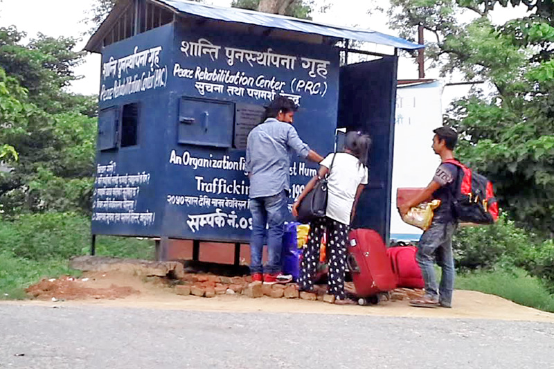 A staffer (left) of Maiti Nepal stops people heading towards India for questioning at nMitranagar border entry point, Kailali, on Wednesday, October 19, 2016. Photo: THT