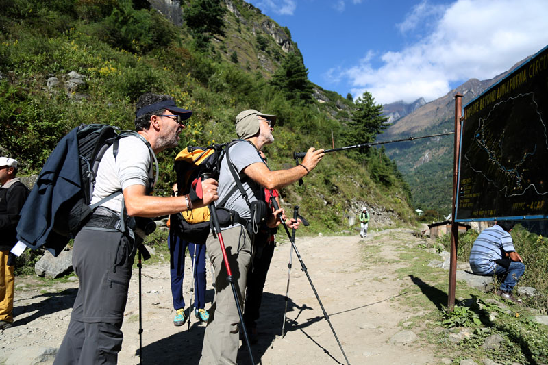 Foreign trekkers read a map in Dharapani of Manang district along the Annapurna trekking trail, on Saturday, October 29, 2016. Photo: RSS