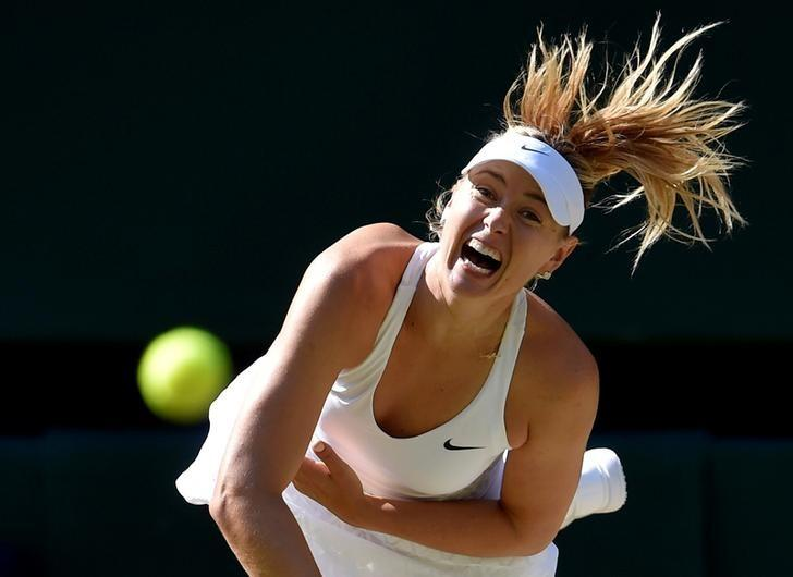 Maria Sharapova of Russia serves during her match against Serena Williams of the U.S.A. at the Wimbledon Tennis Championships in London, July 9, 2015. REUTERS/Toby Melville/Files