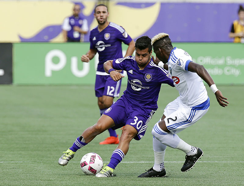Orlando City's Matias Perez Garcia (30) and Montreal Impact's Ambroise Oyongo (2) battle for possession of the ball during the first half of an MLS soccer game, on Sunday, October 2, 2016, in Orlando, Florida. Photo: AP