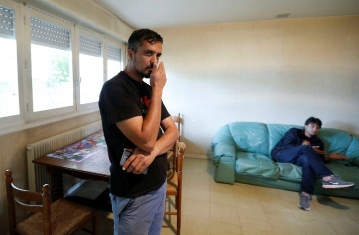 Qadri Fazlullah, a migrant from Afghanistan, poses inside the receptioin centre in Merignac, a suburb of Bordeaux, southwestern France, October 13, 2016, where he lives after resettling three months ago from the Calais jungle camp.     REUTERS/Regis Duvignau