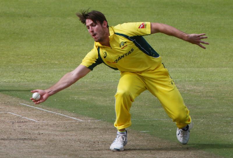Australia's Mitchell Marsh blocks a shot. Photo: Reuters
