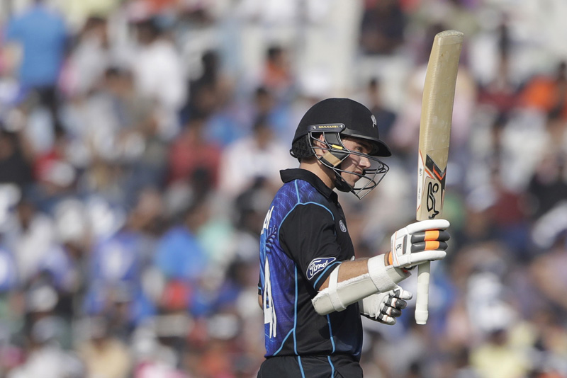 New Zealand's Tom Latham raises a bat after scoring half century against India during their third one-day international cricket match in Mohali, India, Sunday, Oct. 23, 2016. Photo: AP