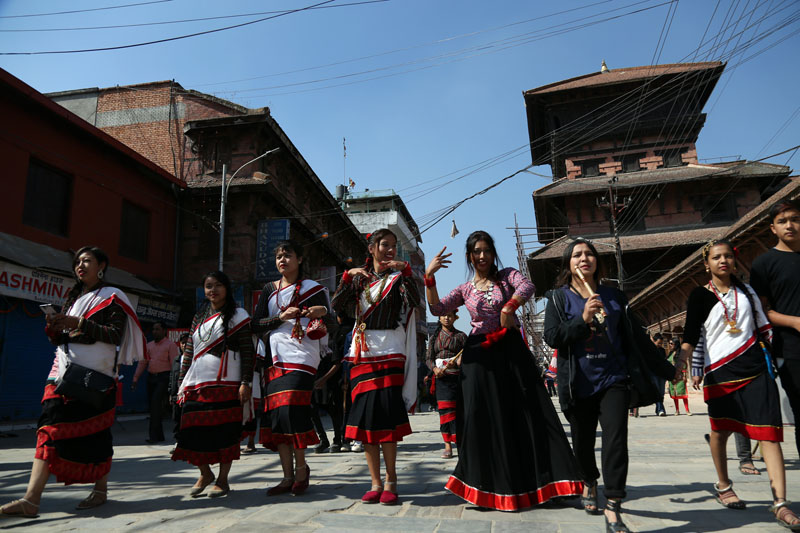 Women from Newar community in their traditional costumes taking part in Vintuna rally organised on the occasion of Newari New Year Nepal Samwat 1137, at Basantapur, in Kathmandu Durbar Square, on Monday, October 31, 2016. Photo: RSS
