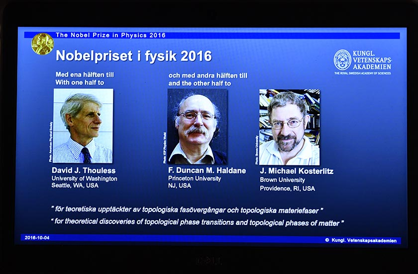 A overhead projector displays the photos of the winners of the Nobel Prize in physics, at the Royal Swedish Academy of Sciences, in Stockholm, Sweden, Tuesday, Oct. 4, 2016. David Thouless, Duncan Haldane and Michael Kosterlitz have won the Nobel physics prize. Nobel jury praises physics winners for 'discoveries of topological phase transitions and topological phases of matter'. (Anders Wiklund /TT via AP)