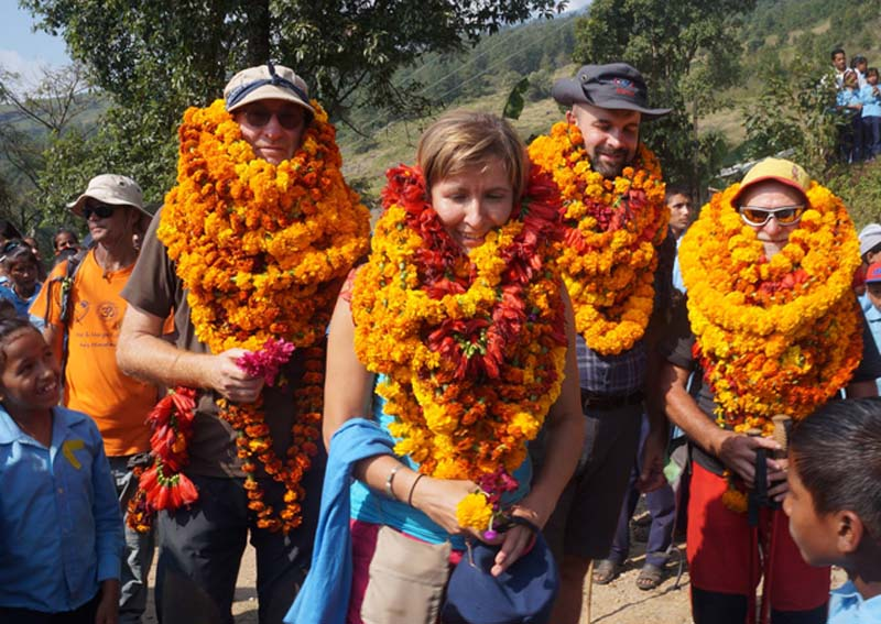 Foreign tourists receive a warm welcome from locals of northern Dhading, on Friday, October 28, 2016. The foreigners were among donors who supported rebuilding four schools in the region. Photo: RSS