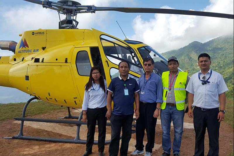 Officials and board of directors of the Altitude Air with newly brought Airbus helicopter after a successful demonstration flight in Manakamana, on Monday, October 3, 2016. Photo Courtesy: Altitude Air