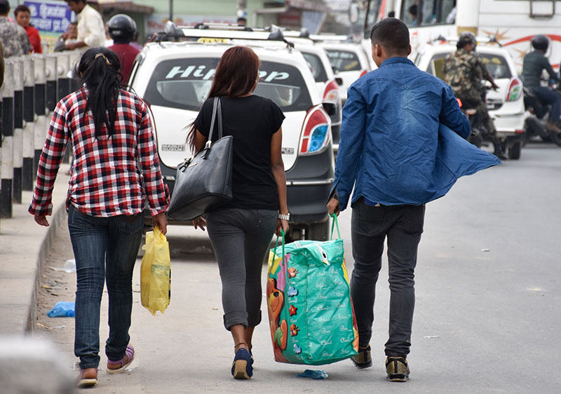 People heading towards their destination upon arriving in Kathmandu after celebrating Dashain in their home districts, in Koteshwor, on Saturday, Obtober 15, 2016. Photo: Naresh Krishna Shrestha/THT