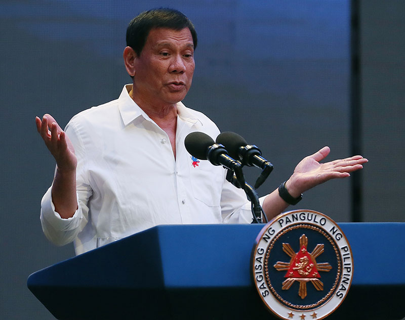 Philippine President Rodrigo Duterte gestures during his address to a Filipino business sector in suburban Pasay city south of Manila, Philippines on Thursday, October 13, 2016. Photo: AP