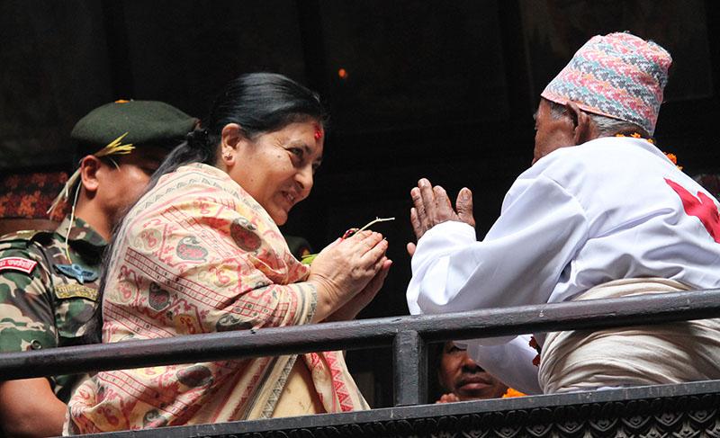 President Bidya Devi Bhandari (left) receives Tika and Jamara from the Priest Julal Karmacharya of Navadurga Temple in Bhaktapur on the occasion of Kojagrat Purnima, on Saturday, October 15, 2016. Photo: RSS