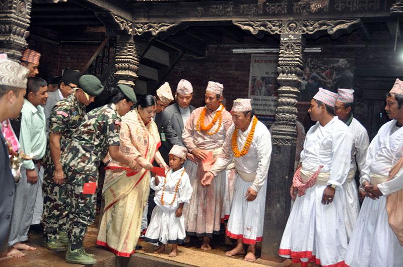 President Bidya Devi Bhandari offers dakshina to the devgans (staff) of Navadurga Temple in Bhaktapur on the occasion of Kojagrat Purnima, on Saturday, October 15, 2016. Photo: RSS