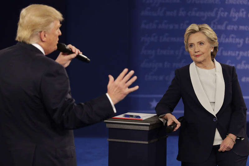 Democratic presidential nominee Hillary Clinton listens to Republican presidential nominee Donald Trump during the second presidential debate at Washington University in St Louis, on Sunday, on October 9, 2016. Photo: AP