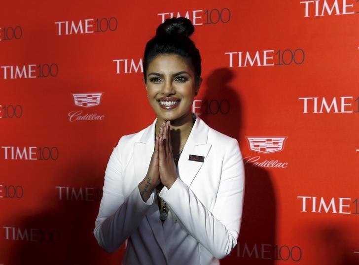 Actress Priyanka Chopra poses for photographers on the red carpet as she arrives for the TIME 100 Gala in Manhattan, New York, April 26, 2016. REUTERS/Shannon Stapleton/Files