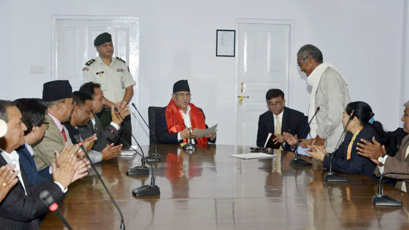 Prime Minister Pushpa Kamal Dahal receives a memorandum submitted by a delegation of Sirahaa district in Baluwatar, Kathmandu on Tuesday, October 25, 2016. Photo: PM's Secretariat.