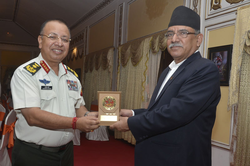 Chief of Army Staff Rajendra Chhetri (left) presents a gift to Prime Minister Pushpa Kamal Dahal as the latter visits the Nepal Army headquarters, in Kathmandu, on Sunday, October 2, 2016. Photo: PM's Secretariat