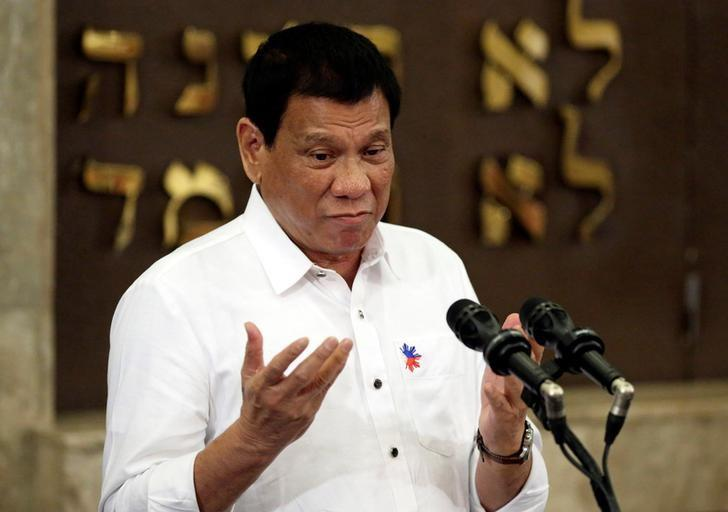 Philippine President Rodrigo Duterte gestures during his speech at the Beit Yaacov Synagogue, The Jewish Association of the Philippines in Makati city, metro Manila, Philippines October 4, 2016. REUTERS/Aaron Favila/Pool