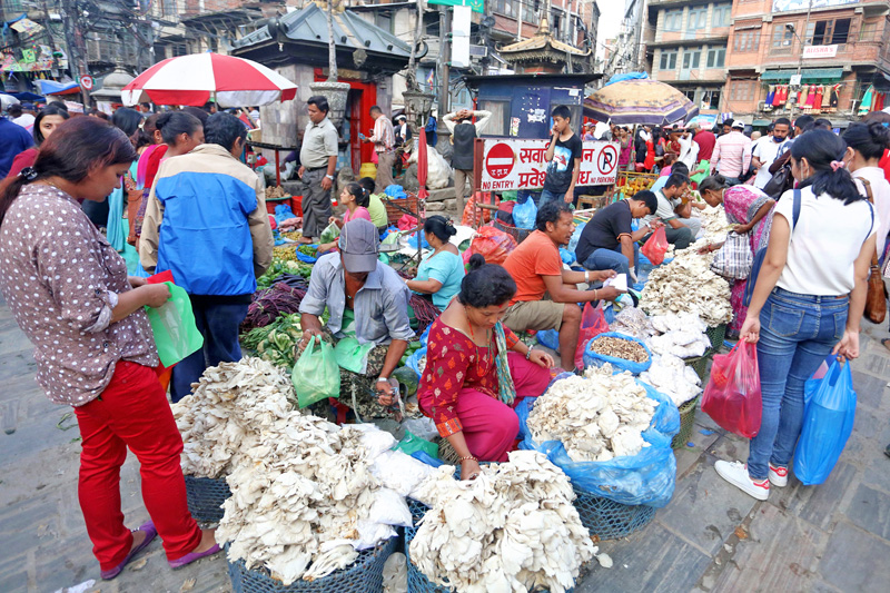 Street vendors waiting consumers at New Road in Kathmandu, on Thursday, October 6, 2016. Photo: RSS