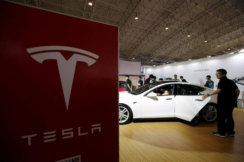 People view a Tesla car during the Auto China 2016 in Beijing, China, on April 25, 2016. Photo: Reuters