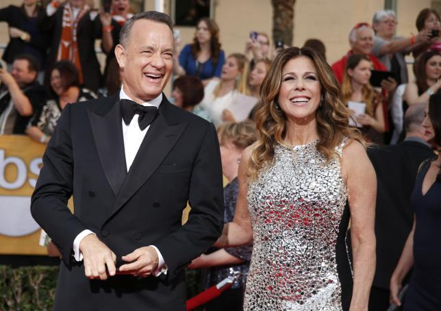Actor Tom Hanks and his wife Rita Wilson arrive at the 20th annual Screen Actors Guild Awards in Los Angeles, California January 18, 2014.  REUTERS/Lucy Nicholson/File Photo