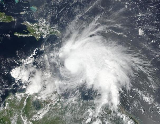 Tropical Storm Matthew, which has since gained hurricane strength, is seen in an image captured by NASA-NOAA's Suomi NPP satellite at 1pm ET (17:00 GMT) September 29, 2016.  NOAA/NASA Goddard MODIS Rapid Response Team/Handout via REUTERS