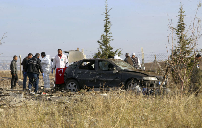 Police forensic officers work at the scene after suicide bombers blew themselves up in Haymana in the outskirts of the capital Ankara, Turkey, on Saturday, October 8, 2016. Photo: DHA via AP